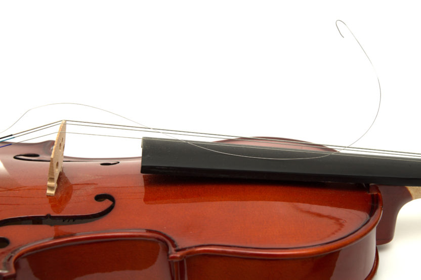 a violin with one broken string