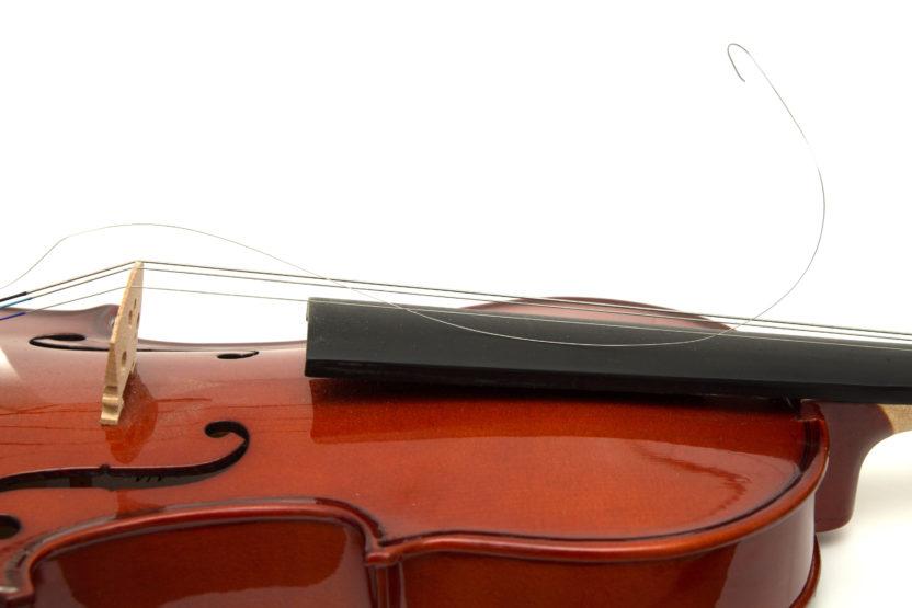 a violin with one broken string